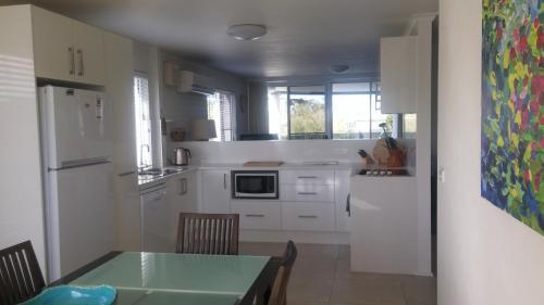 A kitchen or kitchenette at Apollo Luxury Apartments