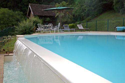 The swimming pool at or near Château De Pray