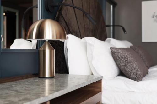 Säng eller sängar i ett rum på Elite Hotel Carolina Tower