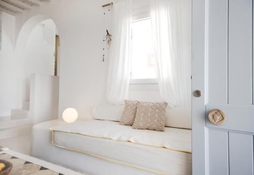Ένα ή περισσότερα κρεβάτια σε δωμάτιο στο Agnandi Cielo
