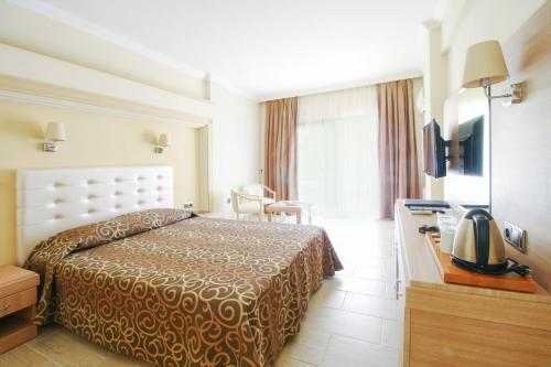 A bed or beds in a room at Azka Hotel