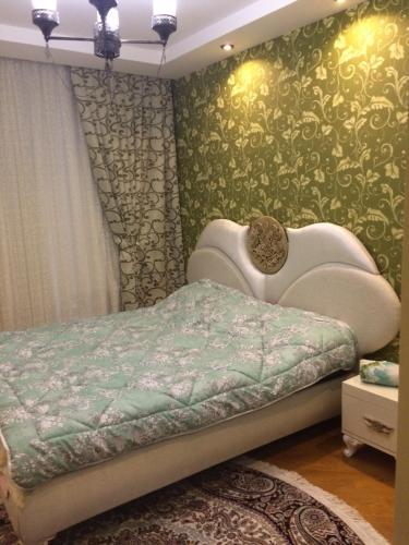 Cama ou camas em um quarto em Host-room for family