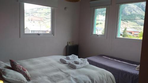 Una cama o camas en una habitación de Ekos de Saint Exupery