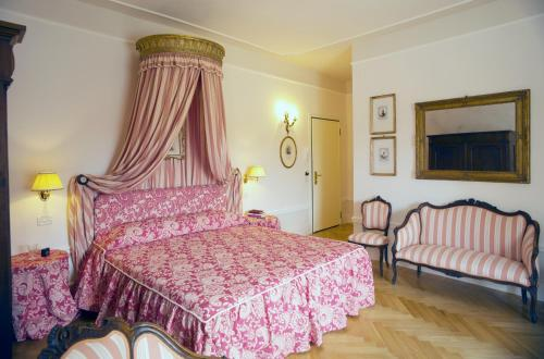 Un ou plusieurs lits dans un hébergement de l'établissement Palazzo Dalla Rosa Prati