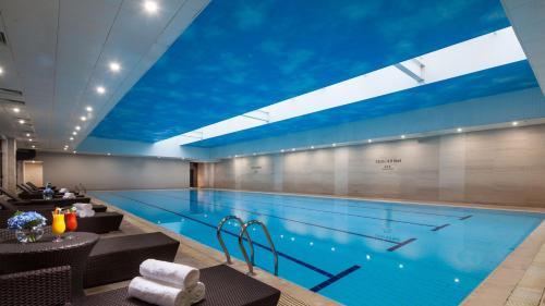 The swimming pool at or near Holiday Inn Shanghai Jinxiu, an IHG Hotel