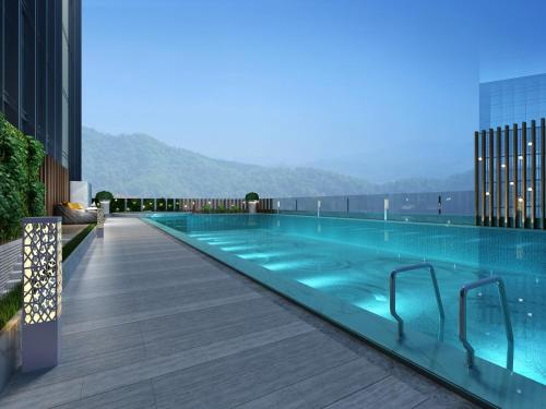 The swimming pool at or near Holiday Inn Guangzhou South Lake, an IHG Hotel
