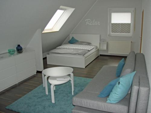 A bed or beds in a room at Ferienwohnung Brandheide