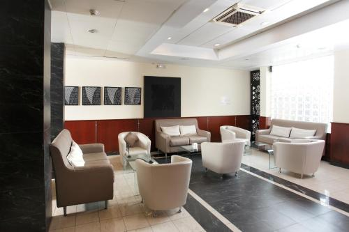 The lounge or bar area at Millennium Gold Hotel