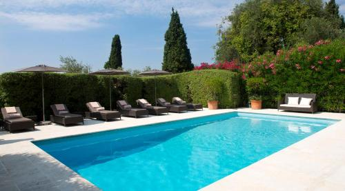The swimming pool at or near Bastide Saint Antoine - Relais & Châteaux