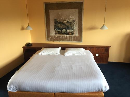 Un ou plusieurs lits dans un hébergement de l'établissement La Belle Vue