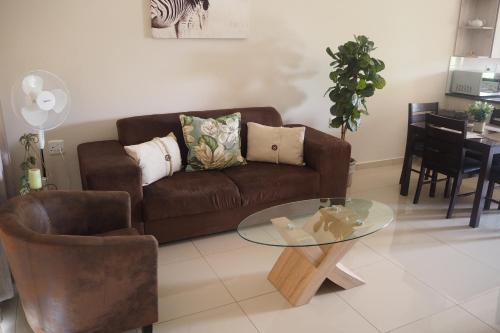 A seating area at OR Tambo Self Catering Apartments
