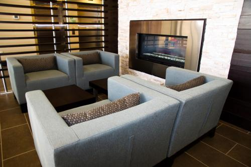 A seating area at Holiday Inn Hotel & Suites Red Deer, an IHG Hotel