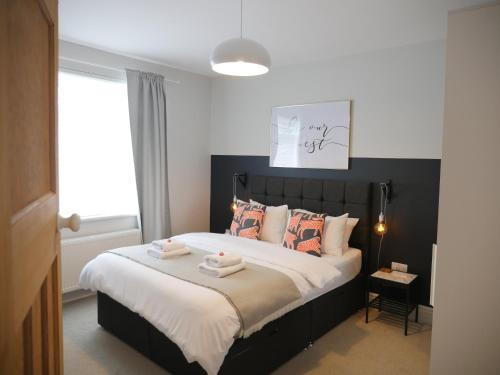 A bed or beds in a room at No.8 Newcastle