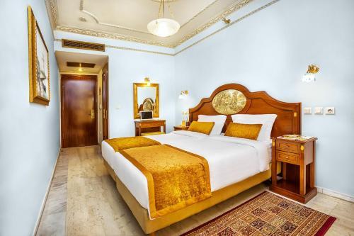 Ένα ή περισσότερα κρεβάτια σε δωμάτιο στο ad Imperial Palace Hotel Thessaloniki
