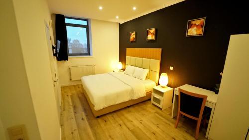 Een bed of bedden in een kamer bij Hotel Flox