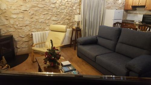 A seating area at Apartamentos rurales La Alquería del Pilar