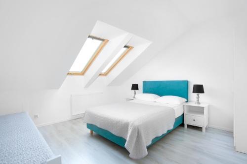 Łóżko lub łóżka w pokoju w obiekcie Apartamenty Góra