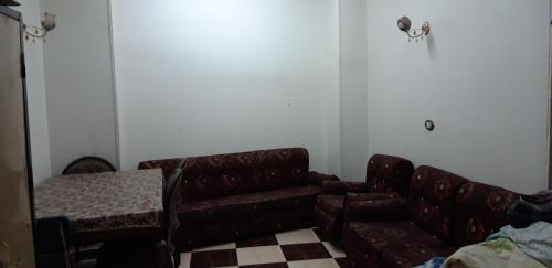 A seating area at Aswan Cozy Apartment