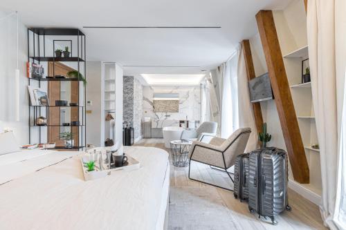 Coin salon dans l'établissement Le Dortoir Multi Storey Luxury Suites