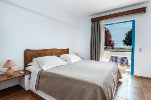 A bed or beds in a room at Olympia Mare