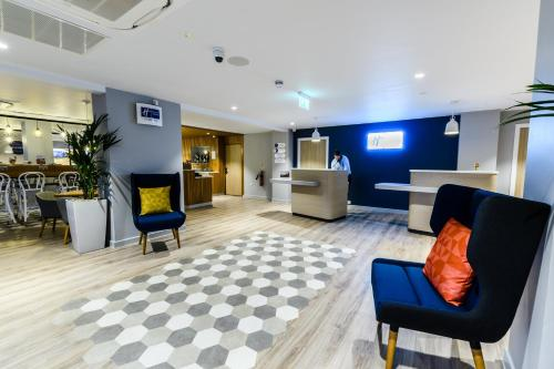 The lobby or reception area at Holiday Inn Express - Wigan, an IHG Hotel