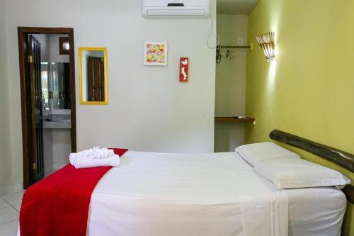 Cama ou camas em um quarto em Pousada Sabor Bahia