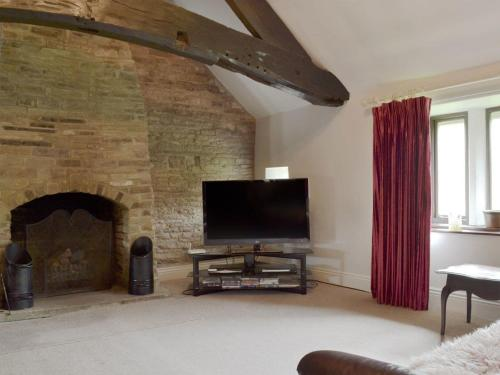 A television and/or entertainment center at Rose Cottage - UK11824