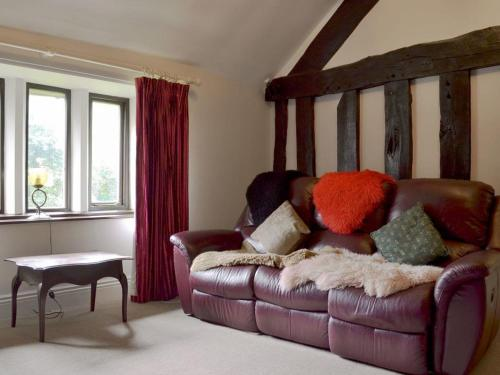 A seating area at Rose Cottage - UK11824