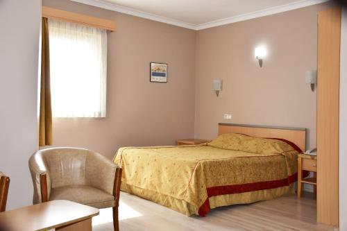 A bed or beds in a room at OTEL AMİLLER