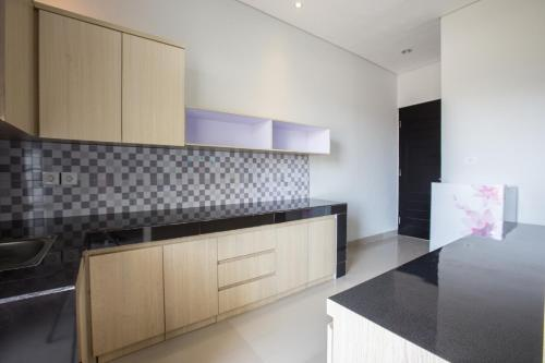 A kitchen or kitchenette at OYO 1949 Vrindavan Residence