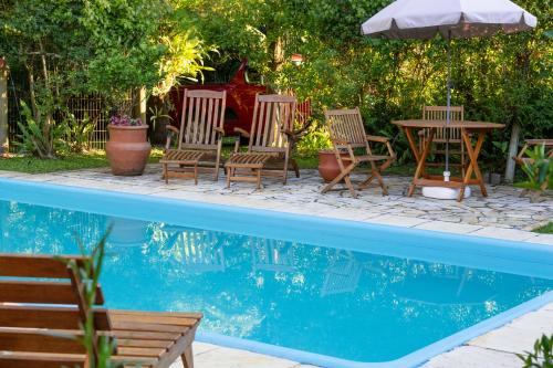 The swimming pool at or near Hotel Pousada Quinta dos Marques