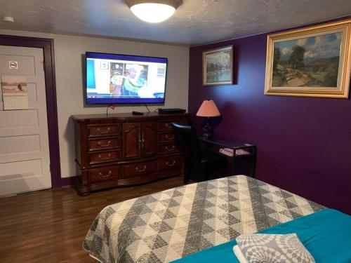 A television and/or entertainment center at Nisku Guest House