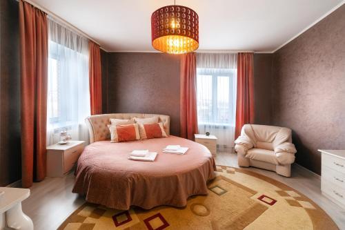 Кровать или кровати в номере Гостиничный Комплекс Буржуй