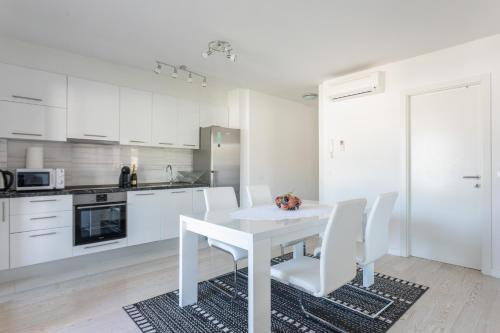 Kuchyňa alebo kuchynka v ubytovaní Comfort Apartment Astra