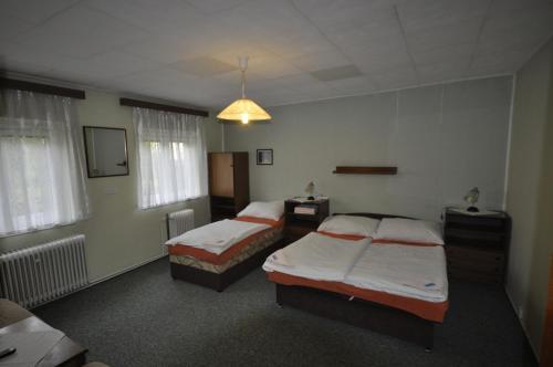 Кровать или кровати в номере Pension Sparta