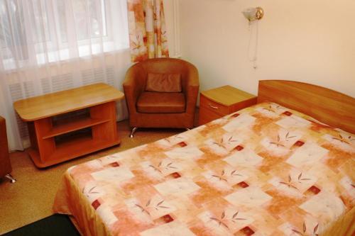 Кровать или кровати в номере Гостиница Люкс