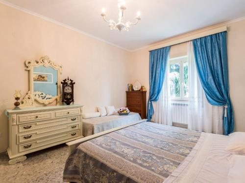 A bed or beds in a room at Locazione Turistica Rossella
