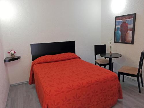 Кровать или кровати в номере Hotel Señorial