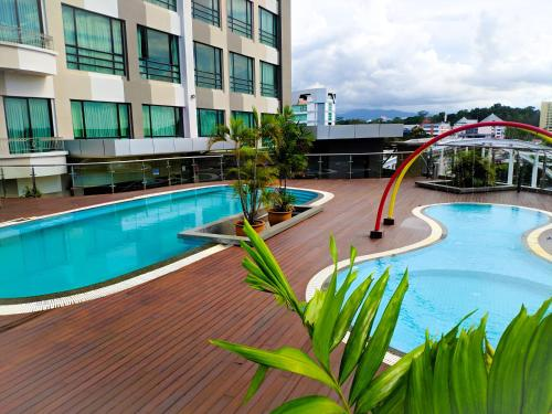 The swimming pool at or near Sabah Oriental Hotel
