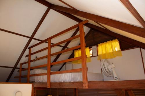 A bed or beds in a room at Nubá Boutique Hostel Palomino