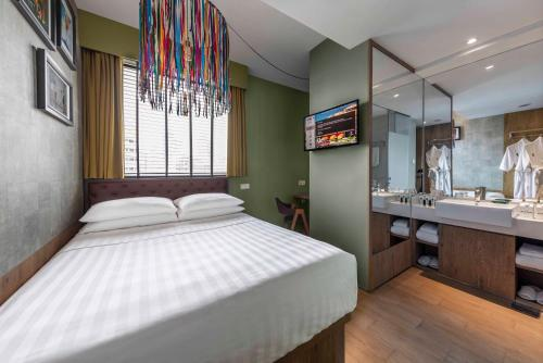 A bed or beds in a room at Hotel G Singapore (SG Clean, Staycation Approved)