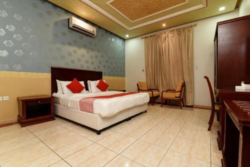 Cama ou camas em um quarto em ElAF ALHAMRA