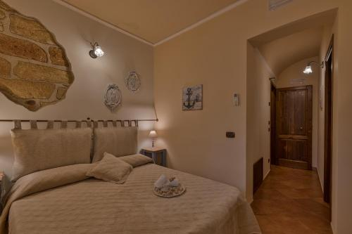 A bed or beds in a room at B&B Le Oasi