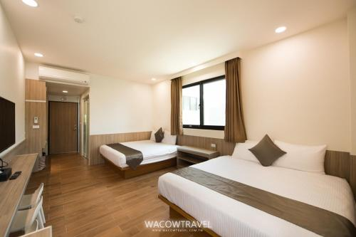 A bed or beds in a room at Venice Seaview Hotel