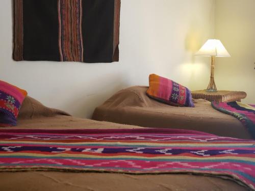 Cama o camas de una habitación en Aruma Codpa