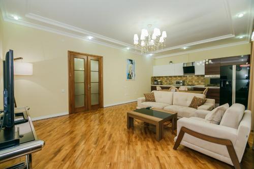 Uma área de estar em Cook Zone Building Apartment by Time Group