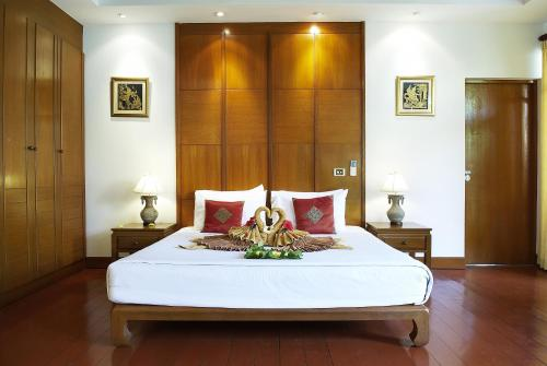 A bed or beds in a room at PP Erawan Palms Resort- SHA Plus