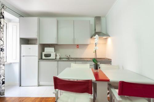 A cozinha ou kitchenette de Lisbon Inn Apartments