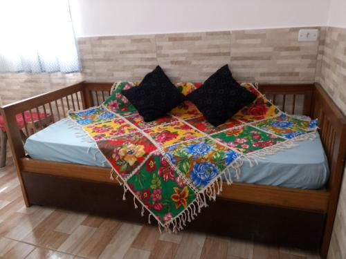 A bed or beds in a room at Chalés Caminho do Mar