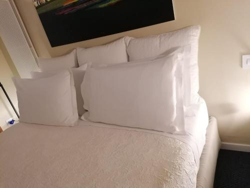 A bed or beds in a room at BC MAISON bed&cafe Milano